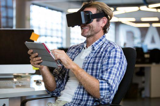 Happy businessman using virtual reality simulator