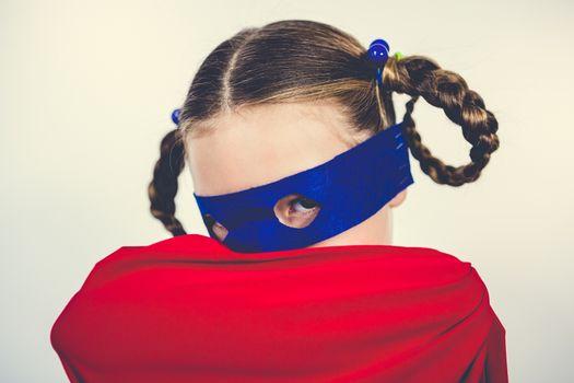Girl pretending to be a superhero