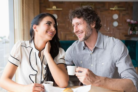 Couple having coffee in cafeteria