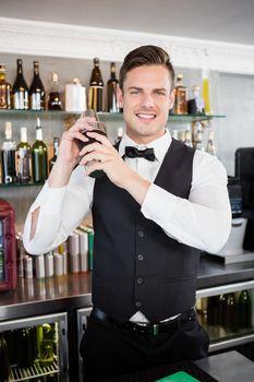 Waiter shaking cocktail