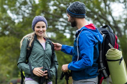 Hiker couple talking to each other