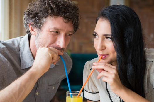 Couple having juice in cafeteria