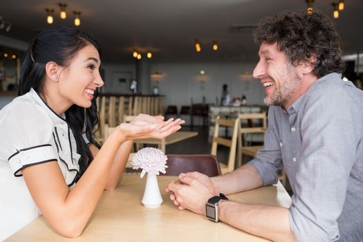 Couple interacting with each other in cafeteria