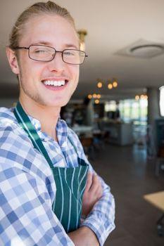 Portrait of waiter smiling