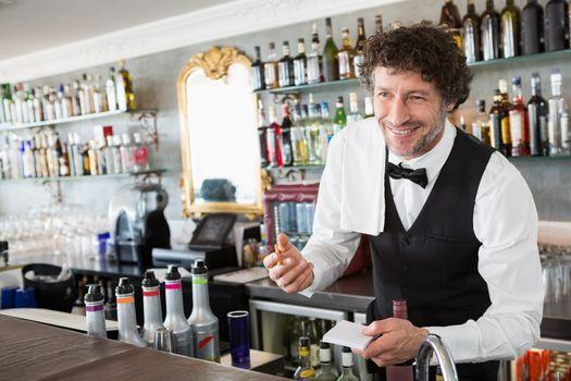 Waiter taking order