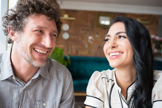 Couple looking at each other in cafeteria