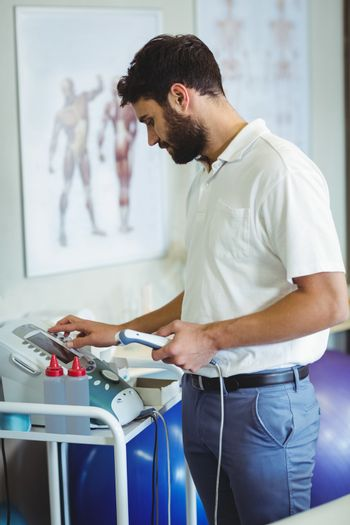 Physiotherapist using therapeutic ultrasound