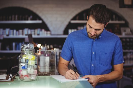Male hairdresser filling a form