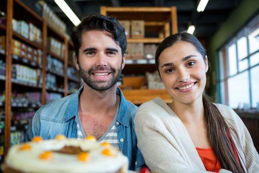 Portrait of happy couple at dessert counter