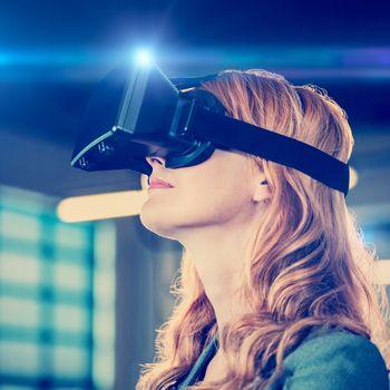 Young businesswoman using virtual reality simulator