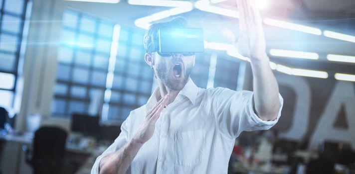 Young businessman using virtual reality simulator
