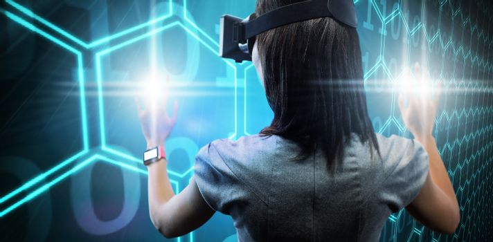 Composite image of woman using a virtual reality device