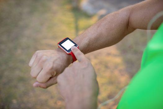 Jogger setting a smartwatch