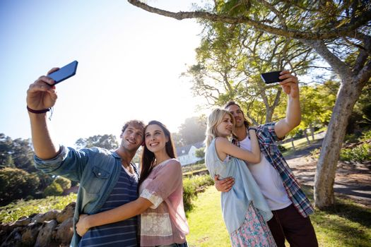 Couples clicking a selfie in park