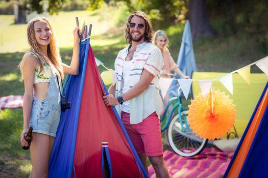 Happy friends at campsite