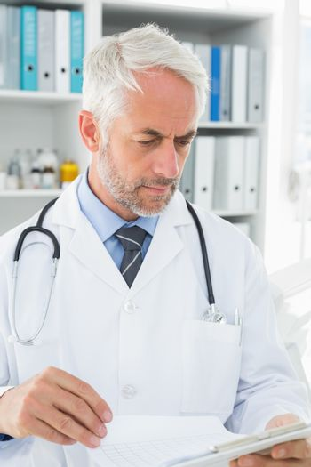 Doctor looking at reports in the medical office