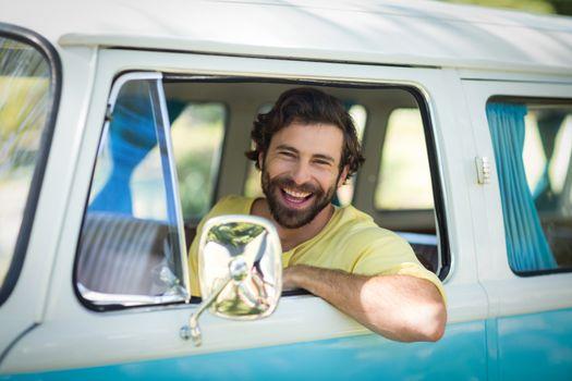 Man looking out of camper van window