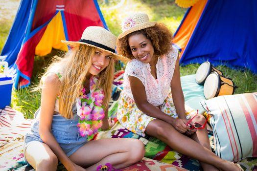 Friends sitting at campsite