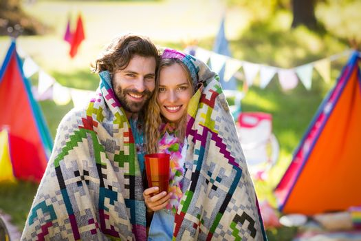 Couple wrap themselves in blanket