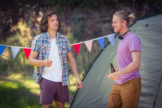 Friends interacting with each other at campsite