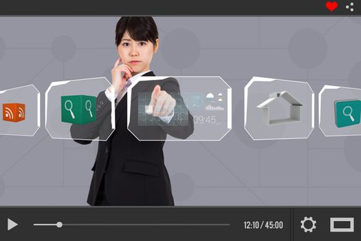 Businesswoman pointing on charts