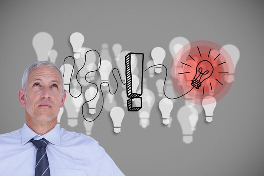 Businessman with light bulb and exclamation mark