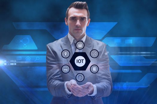 Businessman holding tech icons hologram