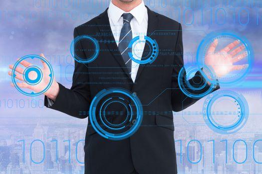 Businessman holding numerical holograms