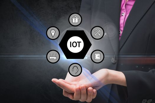 Businesswoman holding tech icons hologram