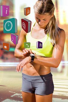 Sportswoman using smart watch