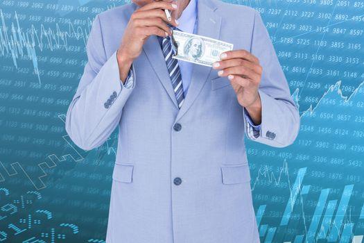 Businessman holding dollars and burn it