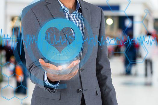 Businessman holding a heart rate hologram