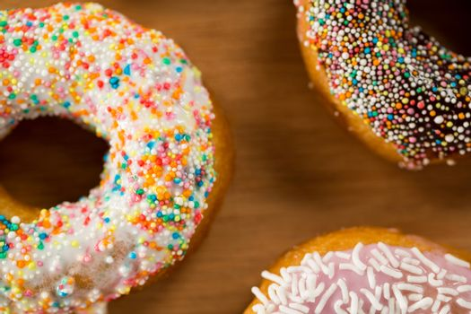 Close-up of tasty doughnuts with sprinkles