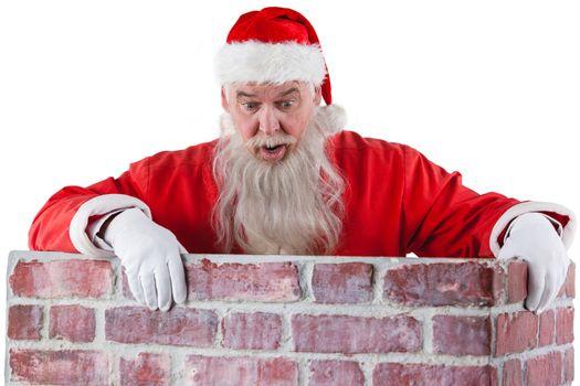 Santa claus peeking over the wall
