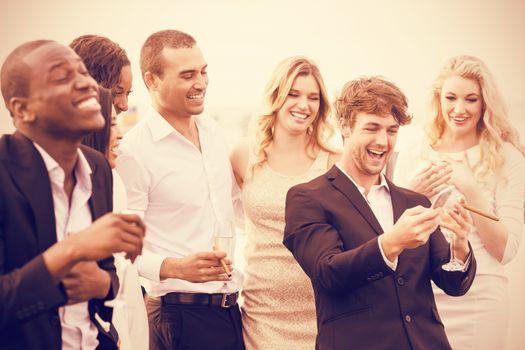 Well dressed people looking smartphone