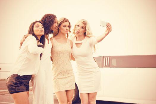 Well dressed women taking selfie