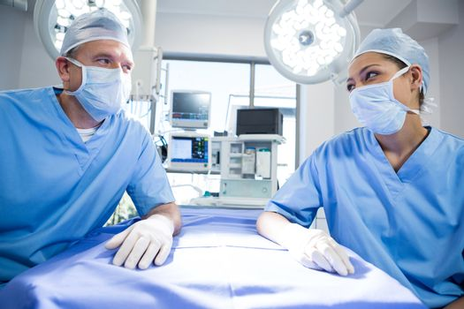 Surgeons interacting with each other