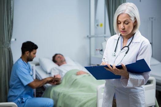 Doctor writing prescription in file