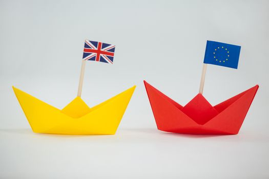 Two paper boats with union jack and european union flag