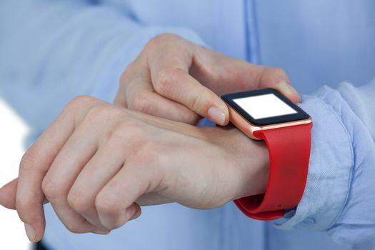 Businesswoman using smartwatch