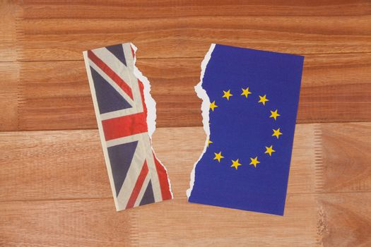 Half torn union jack and european union paper flag