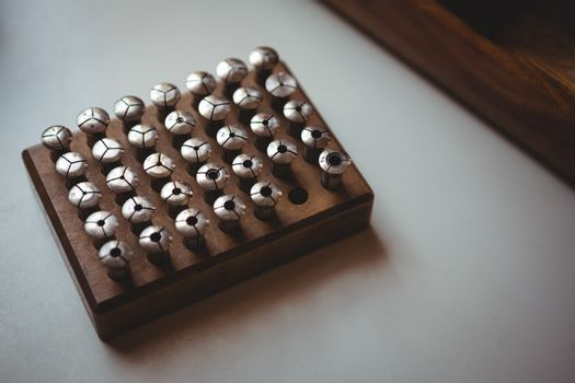 Close-up of screw set in a holder