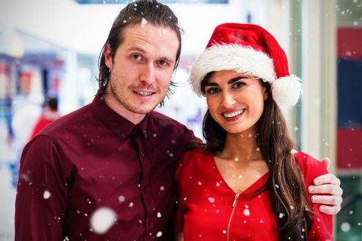Composite image of portrait of couple in christmas attire