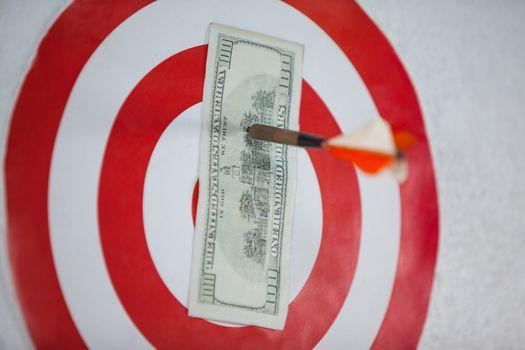 Darted hundred dollars on dart board