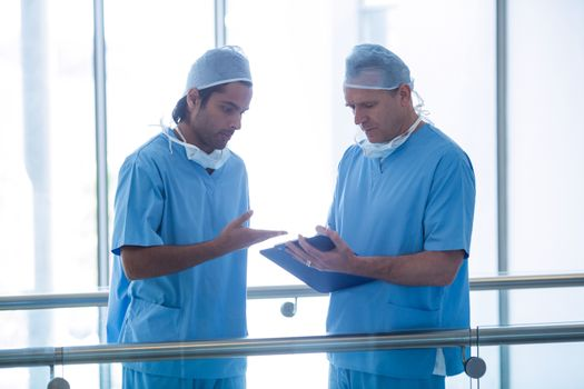 Surgeons discussing over medical reports
