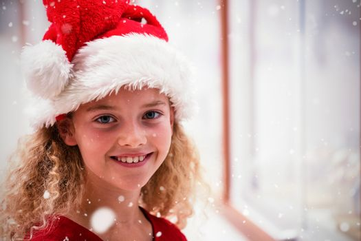 Composite image of portrait of girl in christmas attire