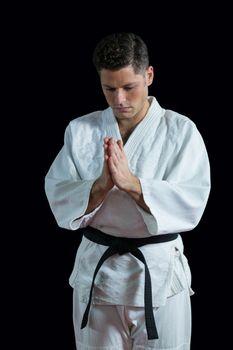 Karate player in prayer pose