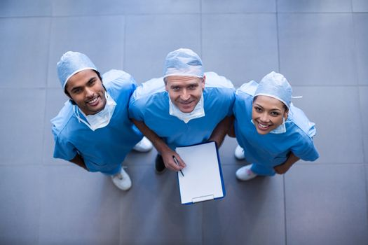 Surgeons with medical reports