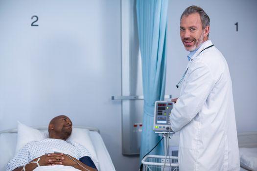 Portrait of doctor smiling in ward during visit