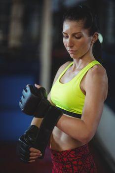Female boxer wearing mma gloves